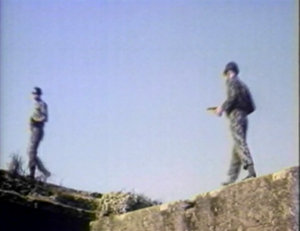 Soldier guards walking on stone walls