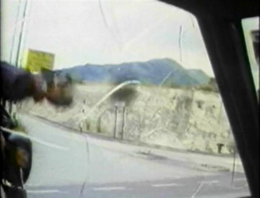 biker breaks car window