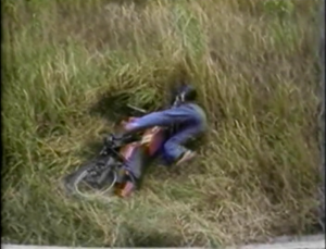 biker wiped out in grass