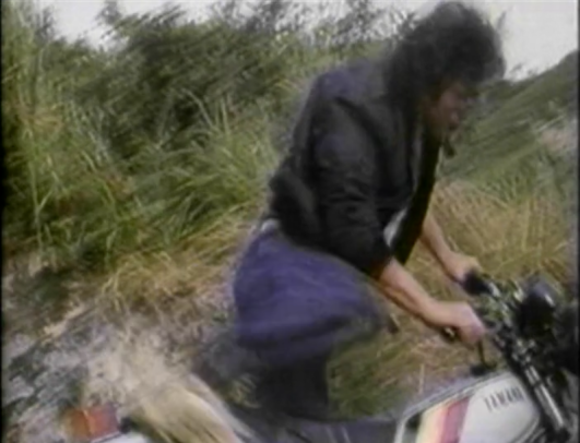 chinese man hopping on dirt bike
