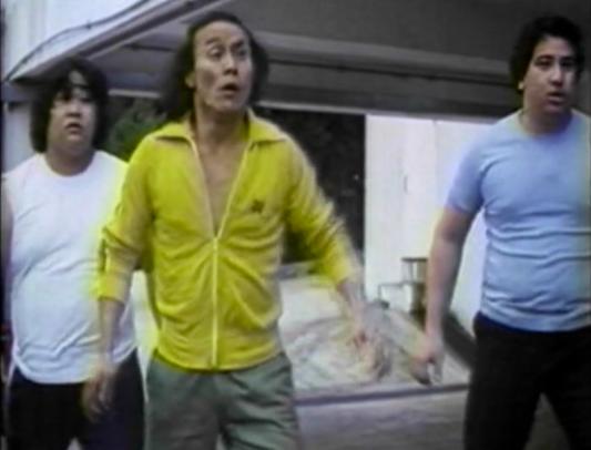three chinese men fighting