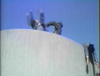 ninja attacks 2 men on tower