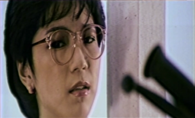 upset Chinese woman with glasses