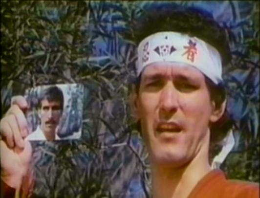 ninja holding photo