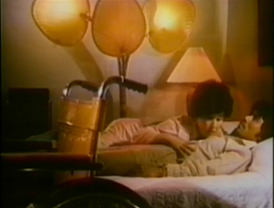 man and woman in bed with wheelchair