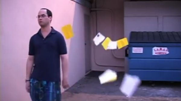 Arthur tearing up application papers