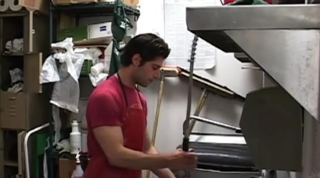 man dishwashing in restaurant