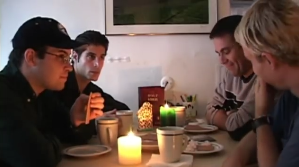 men laughing at dinner table